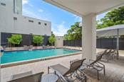 Community pool & outside area. - Condo for sale at 1255 N Gulfstream Ave #1502, Sarasota, FL 34236 - MLS Number is A4413205
