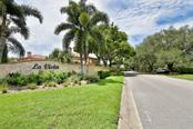 Entrance to La Vista. - Villa for sale at 7686 Calle Facil, Sarasota, FL 34238 - MLS Number is A4413755