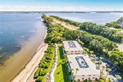 Birdseye view to east and bridge to mainland. - Condo for sale at 600 Manatee Ave #202, Holmes Beach, FL 34217 - MLS Number is A4419465