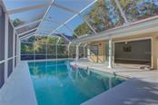 Private pool area allowing plenty of space for entertaining - Single Family Home for sale at 5167 Kestral Park Ln, Sarasota, FL 34231 - MLS Number is A4421162