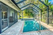 Heated pool with paver bricks - Single Family Home for sale at 5548 Shadow Lawn Dr, Sarasota, FL 34242 - MLS Number is A4423461