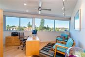 Fascinating angular design for the Office/Den with bamboo flooring and great windows overlooking the waterway! - Single Family Home for sale at 509 Venice Ln, Sarasota, FL 34242 - MLS Number is A4425092