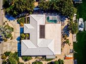 Top view of the house with Canal Aerial - Single Family Home for sale at 622 Dundee Ln, Holmes Beach, FL 34217 - MLS Number is A4426329