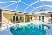 Screened in-ground pool - Single Family Home for sale at 622 Dundee Ln, Holmes Beach, FL 34217 - MLS Number is A4426329