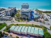 View of building across from Lido Resort and public beach - Condo for sale at 773 Benjamin Franklin Dr #7, Sarasota, FL 34236 - MLS Number is A4427752