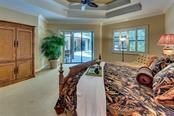 Master suite with view of lanai - Single Family Home for sale at 3753 Eagle Hammock Dr, Sarasota, FL 34240 - MLS Number is A4431001