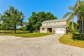 Your barn offers oversized parking, 2 horse stalls (12x12) and an upstairs 1 BR apartment - Single Family Home for sale at 7945 Palmer Blvd, Sarasota, FL 34240 - MLS Number is A4431318