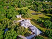 Aerial view of the 3 buildings, pastures and pond - Single Family Home for sale at 7945 Palmer Blvd, Sarasota, FL 34240 - MLS Number is A4431318