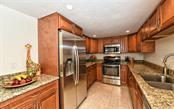 Updated kitchen with stainless steel appliances, granite counters & wood cabinets. - Condo for sale at 101 S Gulfstream Ave #6d, Sarasota, FL 34236 - MLS Number is A4434802