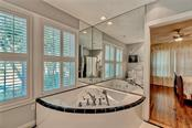 Relax in the privacy of your own whirlpool/jetted tub in the master bathroom. - Single Family Home for sale at 813 Hudson Ave, Sarasota, FL 34236 - MLS Number is A4437601