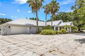 Oversized garage with additional parking pad and could add another 2 car garage ! WOW !!! Bring on the RV  and boats ! - Single Family Home for sale at 1810 21st St W, Palmetto, FL 34221 - MLS Number is A4438160