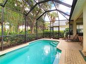 Relax by the pool and enjoy beautiful landscaping - Single Family Home for sale at 348 Melrose Ct, Venice, FL 34292 - MLS Number is A4439531