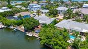 A lift for your boat, a floating dock, and a cute fisherman's storage shed in the well landscaped back yard. - Single Family Home for sale at 701 Norton St, Longboat Key, FL 34228 - MLS Number is A4440596