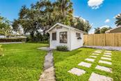 Charming outdoor shed with large windows. - Single Family Home for sale at 1763 6th St, Sarasota, FL 34236 - MLS Number is A4442510