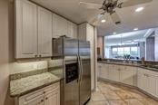 The kitchen is open to the great room allowing natural light to flow through. - Condo for sale at 5420 Eagles Point Cir #204, Sarasota, FL 34231 - MLS Number is A4454318