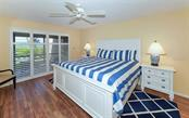 Master Bedroom with sliders to Lanai - Condo for sale at 5635 Gulf Of Mexico Dr #102, Longboat Key, FL 34228 - MLS Number is A4458745
