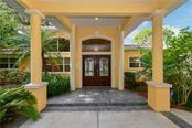 Impressive entrance. Just pull right up and park under the covered portico. - Single Family Home for sale at 1332 Quail Dr, Sarasota, FL 34231 - MLS Number is A4458756