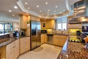 Spacious, well-organized gourmet kitchen with gulf views (and city lights view in the evening). Trayed ceiling with special tiny spot lights - Condo for sale at 5880 Midnight Pass Rd #911, Sarasota, FL 34242 - MLS Number is A4462559