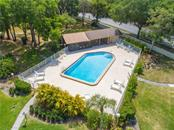 Aerial View of Pool and Screen Ramada in Village 1 - Villa for sale at 4335 Rum Cay Cir, Sarasota, FL 34233 - MLS Number is A4463762