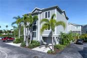 Two garages with ample visitor parking. - Condo for sale at 515 Forest Way, Longboat Key, FL 34228 - MLS Number is A4465231