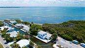 Single Family Home for sale at 735 Saint Judes Dr S, Longboat Key, FL 34228 - MLS Number is A4468349