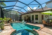 Screened in outdoor lanai with automatic cleaners for pool and spa. - Single Family Home for sale at 1907 Clematis St, Sarasota, FL 34239 - MLS Number is A4474600