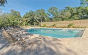 Community Pool - Single Family Home for sale at 3538 Trebor Ln, Sarasota, FL 34235 - MLS Number is A4475545