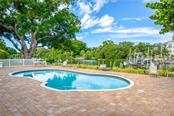 Free-form Saltwater Pool with Expansive Paver Lanai Overlooking the Hudson Bayou - Single Family Home for sale at 1595 Bay Point Dr, Sarasota, FL 34236 - MLS Number is A4479218