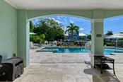 First floor patio. - Single Family Home for sale at 718 Key Royale Dr, Holmes Beach, FL 34217 - MLS Number is A4480381