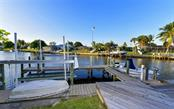 Boat lift, PRAM, dock, dock light and water supply - Single Family Home for sale at 9219 Bimini Dr, Bradenton, FL 34210 - MLS Number is A4483083