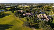 ONE OF THE ONLY ESTATE PROPERTIES ON THE MARKET - PRIVACY & PEACEFULNESS ABOUNDS. FAIRWAY HOLES #6 & #7 IN YOUR BACKYARD & PONDS W/ DEER GREET YOU IN YOUR FRONT YARD. - Single Family Home for sale at 8263 Archers Ct, Sarasota, FL 34240 - MLS Number is A4483993