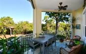 Open balcony overlooking the peaceful preserve. - Condo for sale at 7730 34th Ave W #102, Bradenton, FL 34209 - MLS Number is A4486333