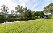 Relaxing pond view from villa. - Villa for sale at 3314 Vivienda Blvd, Bradenton, FL 34207 - MLS Number is A4488348