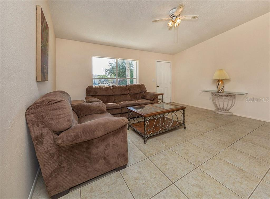 Living Room - Single Family Home for sale at 10308 Grail Ave, Englewood, FL 34224 - MLS Number is N5911429