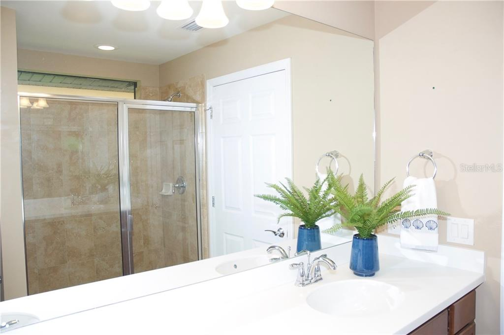 Master bath with walk-in shower - Single Family Home for sale at 19261 Isadora St, Venice, FL 34293 - MLS Number is N5911485