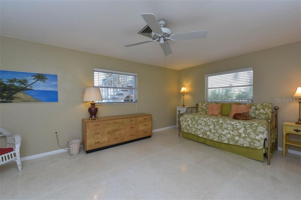 1st floor bedroom 2 - Single Family Home for sale at 725 El Dorado Dr, Venice, FL 34285 - MLS Number is N5911780