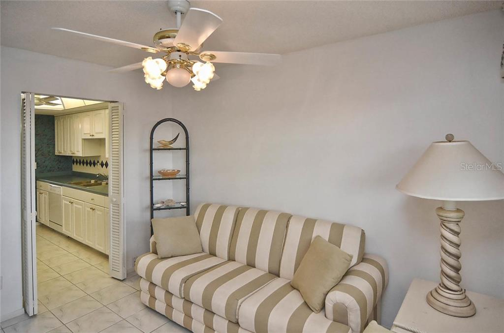 Den to kitchen - Condo for sale at 255 The Esplanade N #805, Venice, FL 34285 - MLS Number is N5912261