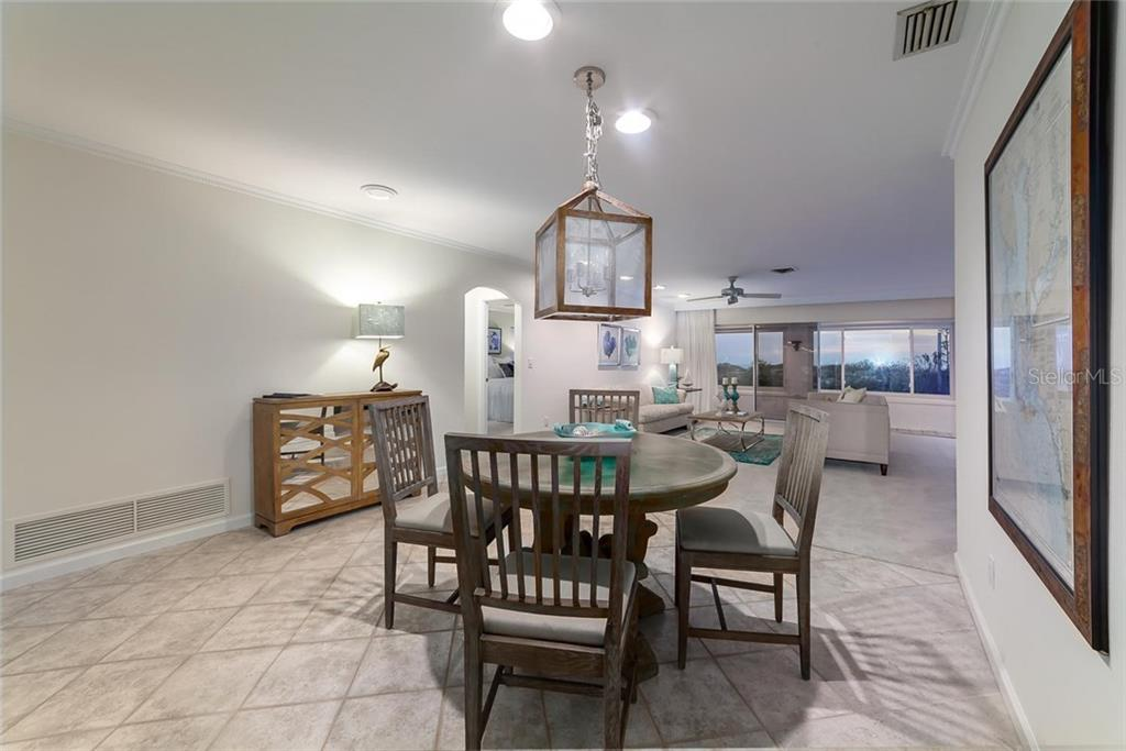Dining Room - Villa for sale at 710 Golden Beach Blvd #v4, Venice, FL 34285 - MLS Number is N5912832