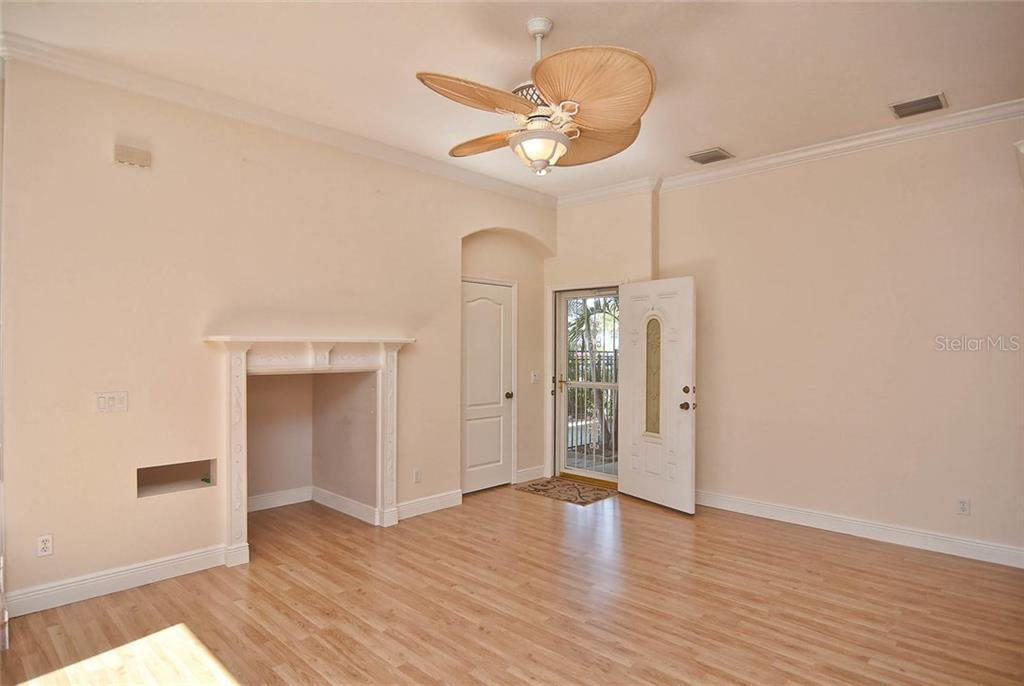 Living room/entry - Condo for sale at 501 Barcelona Ave #c, Venice, FL 34285 - MLS Number is N5913183
