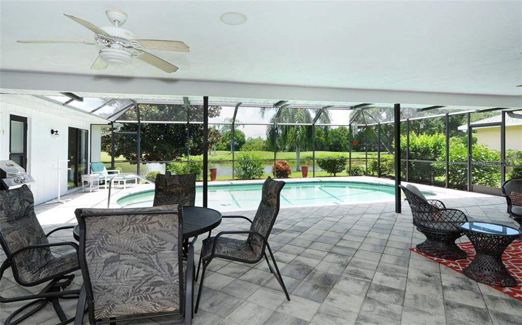 Spacious Lanai  With Pool and View of the Pond - Single Family Home for sale at 1930 Innisbrook Ct, Venice, FL 34293 - MLS Number is N5913572