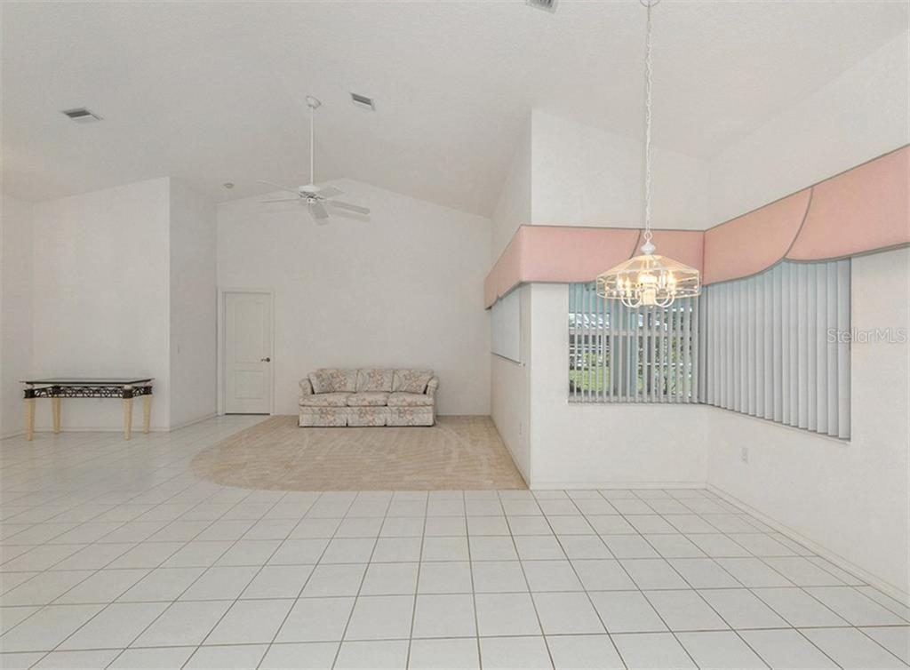 Dinette to living room - Single Family Home for sale at 683 May Apple Way, Venice, FL 34293 - MLS Number is N5913909