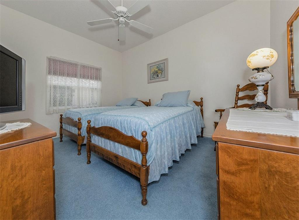 Bedroom 2 - Single Family Home for sale at 577 Park Estates Sq, Venice, FL 34293 - MLS Number is N5914129