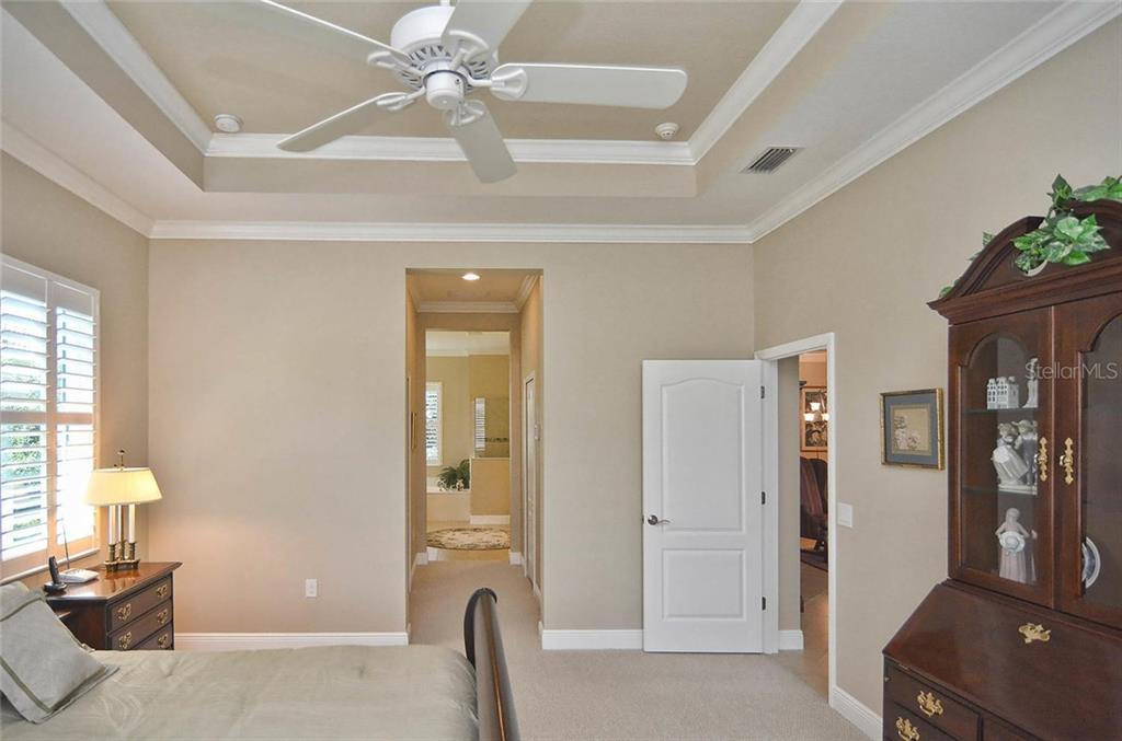 Master bedroom to master bath - Single Family Home for sale at 293 Marsh Creek Rd, Venice, FL 34292 - MLS Number is N5914238