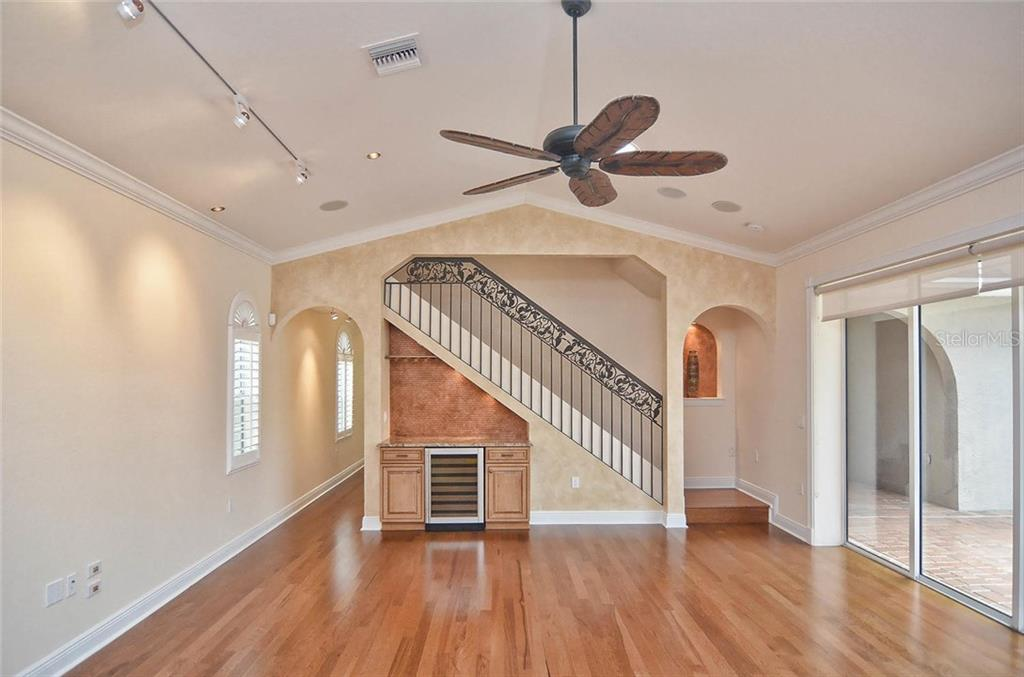 Living room to stairway and sliders to pool - Single Family Home for sale at 248 Pensacola Rd, Venice, FL 34285 - MLS Number is N5914299