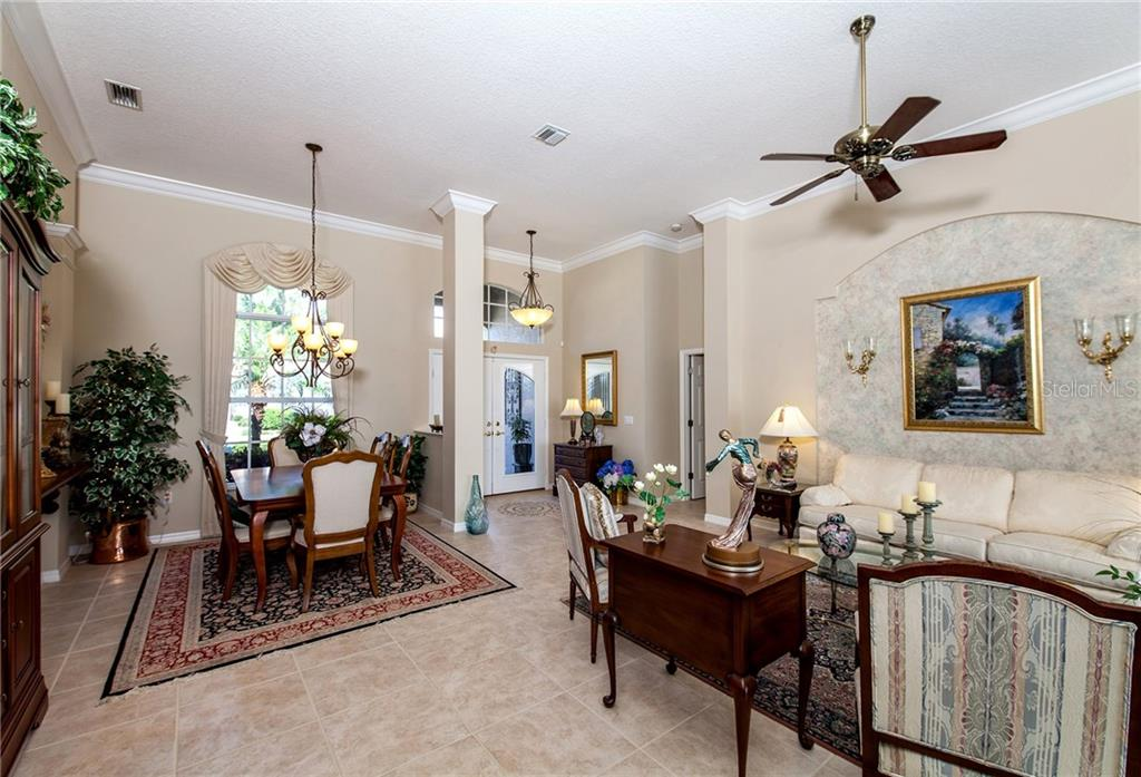 Dining Room to Leaded Glass Front Doors - Single Family Home for sale at 366 Turtleback Xing, Venice, FL 34292 - MLS Number is N5914504