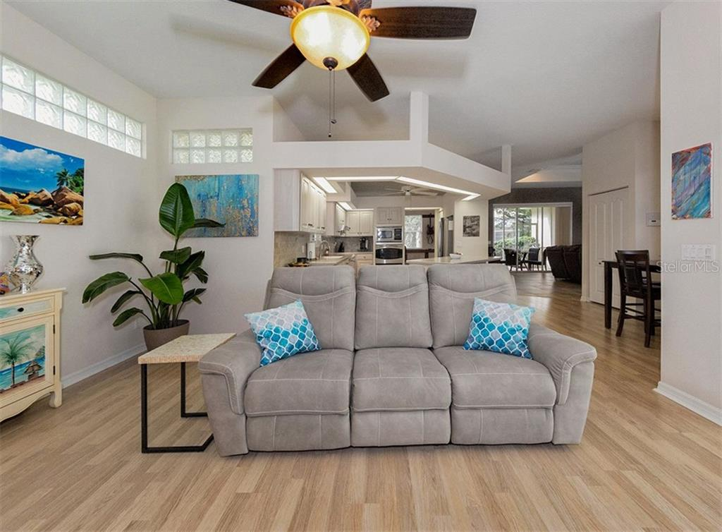 Family room to kitchen - Single Family Home for sale at 530 Waterwood Ln, Venice, FL 34293 - MLS Number is N5914538