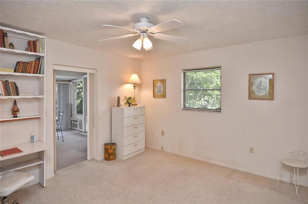 Guest bedroom to Florida room - Single Family Home for sale at 1410 Strada D Argento, Venice, FL 34292 - MLS Number is N5914540