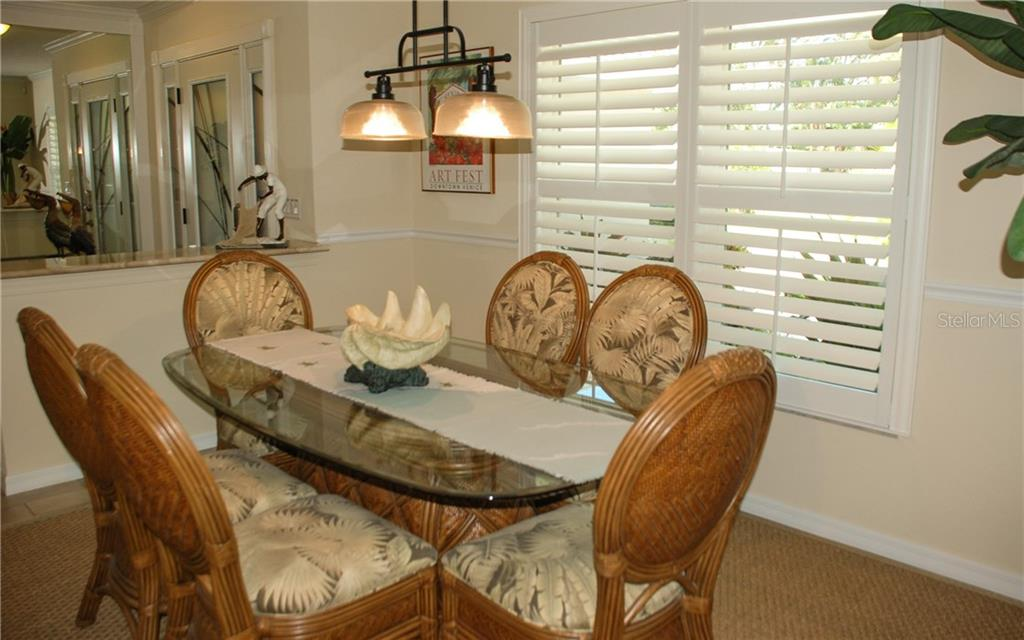 Dining room - Single Family Home for sale at 600 Portia St N, Nokomis, FL 34275 - MLS Number is N5914547