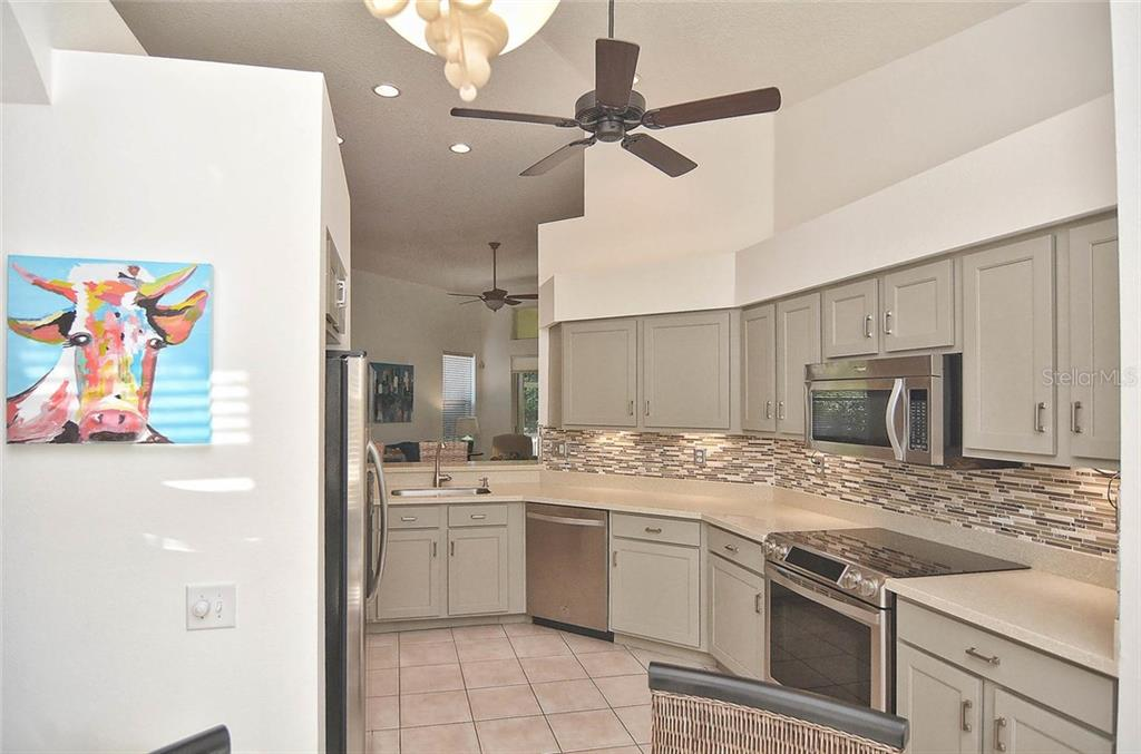 Kitchen from breakfast nook. - Single Family Home for sale at 498 Meadow Sweet Cir, Osprey, FL 34229 - MLS Number is N5914789
