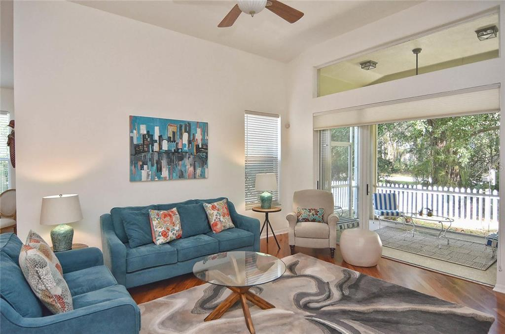 Great room with sliders to lanai. - Single Family Home for sale at 498 Meadow Sweet Cir, Osprey, FL 34229 - MLS Number is N5914789
